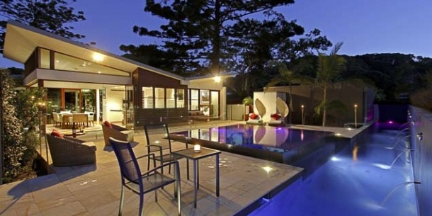 Oceania / Australia / Broken Head ->  We are a | Contemporary pavilion home offering complete privacy and unbeatable style    Where | Nestled in an Australian rainforest with a private track over the sand dunes to one of the world's top 100 rated right-hand point breaks    Why stay | For the resort-style facilities including a stunning pool, the proximity to the beach and the stunning contemporary architecture | www.SwapNights.com