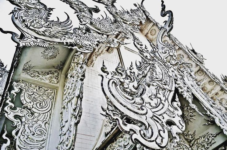 I took this photo at Wat Rong Khun Temple in Chiang Rai Thailand.  Better know to foreigners as the White Temple the contemporary unconventional art exhibition in the style of a Buddhist temple is well worth a visit! . . #explorethailand #thailand #thailand_ig #whitetemple #traveltheworld #passportready #instapassport #mytravelgram #travelstoke #travelblog #travelblogger #thetravelguru #theworldguru #nakedplanet #theglobewanderer #fullfotos #solotraveler #aroundtheworld #igtravel…
