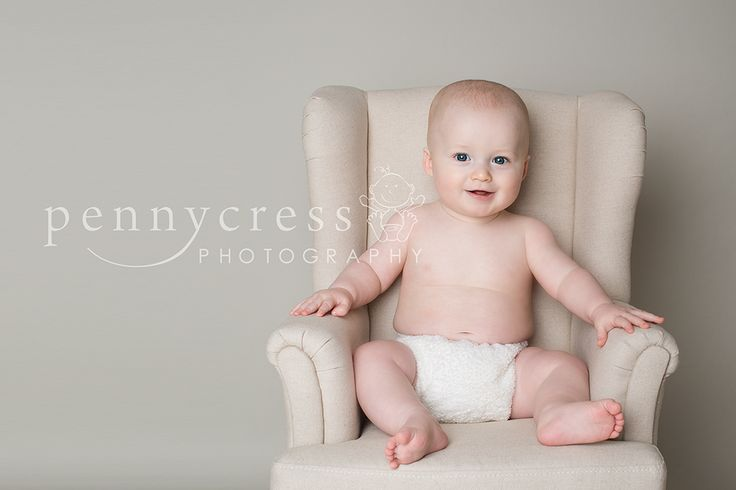 Baby sitting up on an armchair. Baby Portrait of an older baby