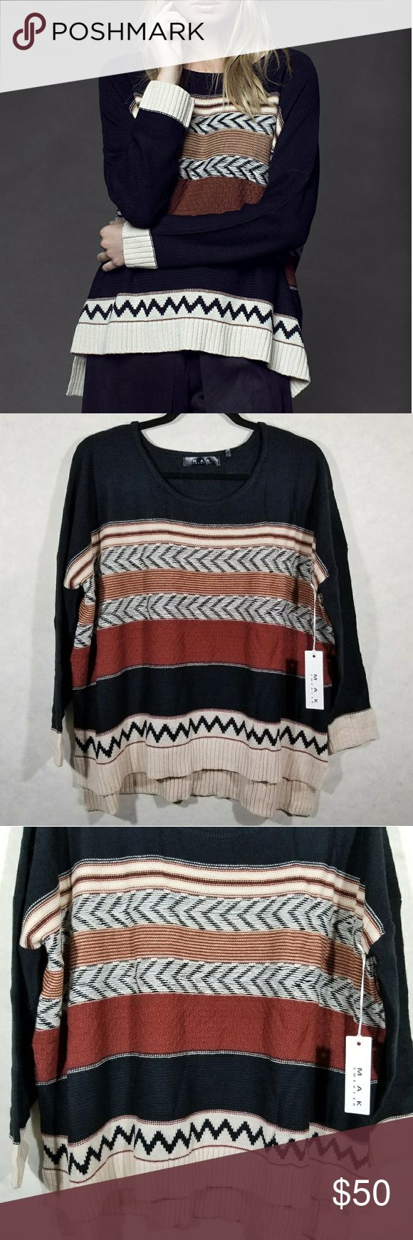 """NET MAK Black Oversized Dominga Tribal Sweater Adorable and sofy light weight horizontal knit pattern - perfect for fall. 100% acrylic tribal pattern. No flaws.  Size tag says S/M. Oversized fit. Check measurements to ensure you love the fit.  Chest armpit to armpit 54"""" Sleeve length from shoulder ~22"""" Top to bottom from shoulder front 22.75"""" back 25.25"""" MAK Sweaters Crew & Scoop Necks"""