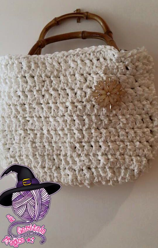 White bag with flower brooch