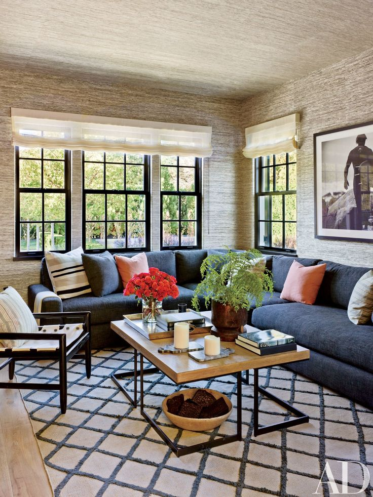 The TV room of this Southampton, New York, residence by Sawyer Berson is appointed with an RH sectional in a Perennials fabric and a flat-weave rug by RH; the abaca wall covering is from Donghia.