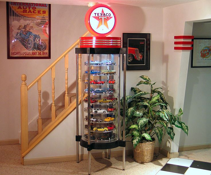 Take one repurposed wristwatch display case, add a petroliana topper, and you've got a model car display case that fits seamlessly and unobtrusively into a nostalgic man-cave.