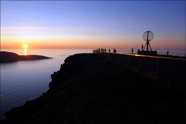 Norway: Nordkapp (North Cape). The cape includes a 307-metre (1,007 ft) high cliff with a large flat plateau on top where visitors can stand and watch the midnight sun or the views of the Barents Sea to the north.