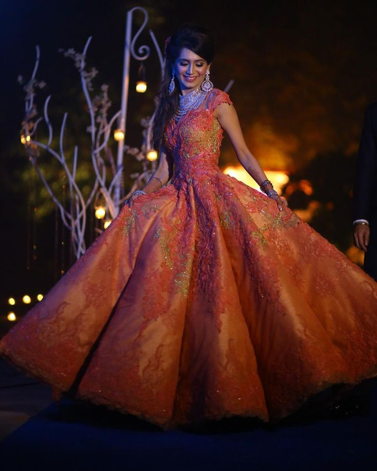 """Meghnit has her Cinderella moment in an orange embroidered @solteebysulakshanamonga gown teamed with diamond jewellery."""