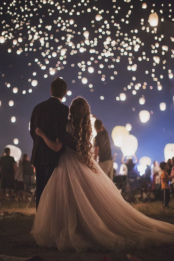The Lantern Fest, a traveling festival that unites revelers with an evening of live music, dancing, marshmallow roasting, and setting the darkened sky aglow with floating luminaries carrying hundreds of hopes and dreams, provided the perfect occasion for one Utah couple to carry out a Tangled-themed engagement session. Captured by Beyond The Darkroom Photography, the final images are hypnotically beautiful.