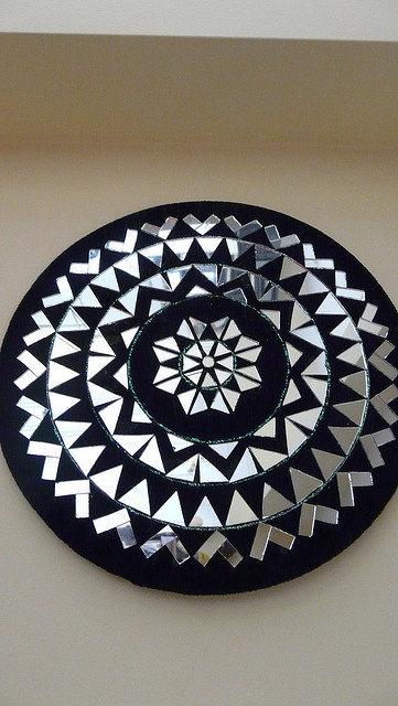 Mirror Mandala designed and created by pasting little cut pieces of mirrors to suite the design