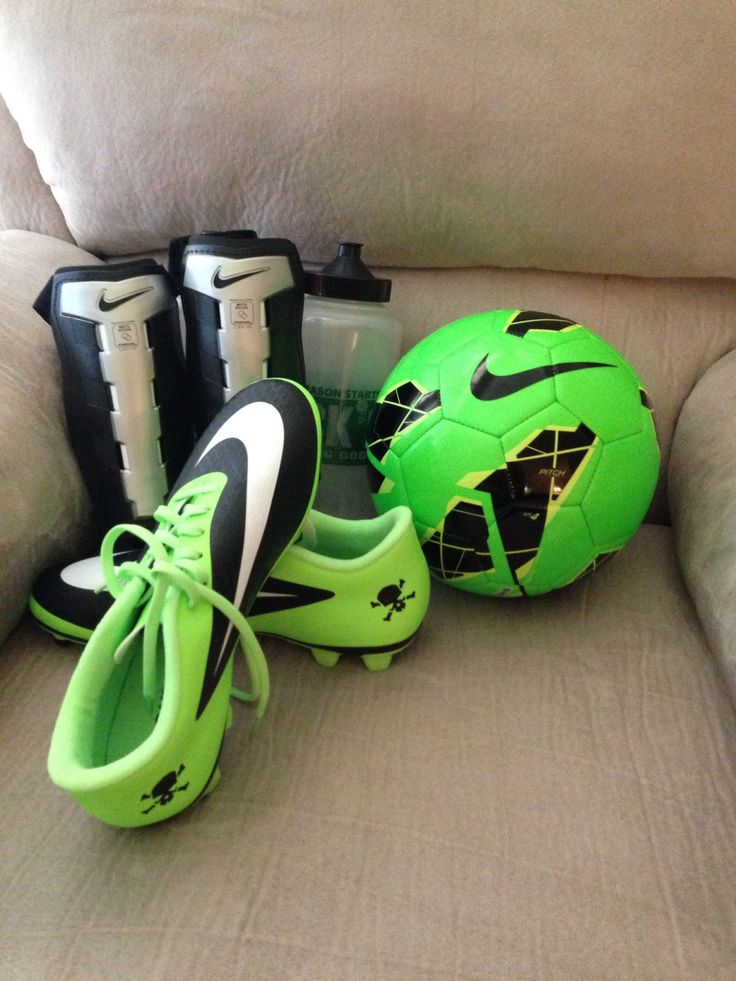 Blue and white soccer gear cleats shin pads ball