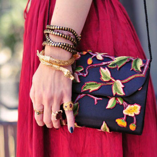 Turn a plain old satin handbag into a beautifully unique floral embroidered evening bag or clutch with this easy DIY