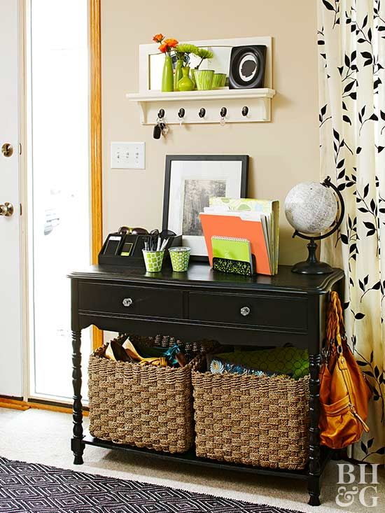 Prevent a small entry from looking cramped and cluttered by banishing unnecessary items and creating distinct homes for the things that stay. This tiny entryway packs a punch with style and function, outfitted with a small desk, deep storage baskets, an overhead shelf, and desktop organizers that corral keys, mail, and electronics. The desk drawers also feature mesh drawer organizers to ensure their contents stay neat and tidy.