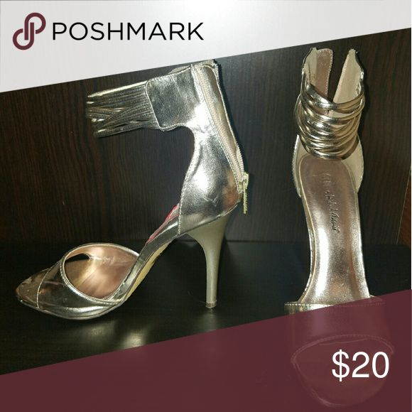 Silver strappy heels Used these for a Jasmine costume , super cute ! Shoes Heels