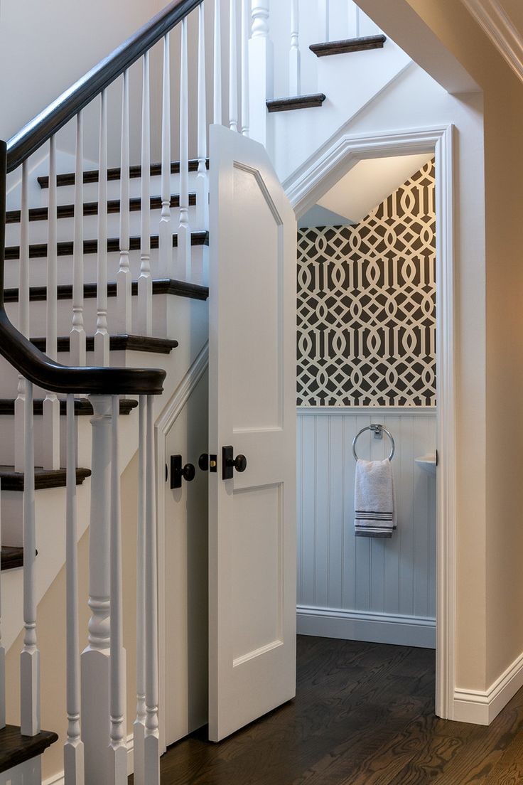 a charming hallway powder room under the main staircase - Bathroom Designs Under Stairs