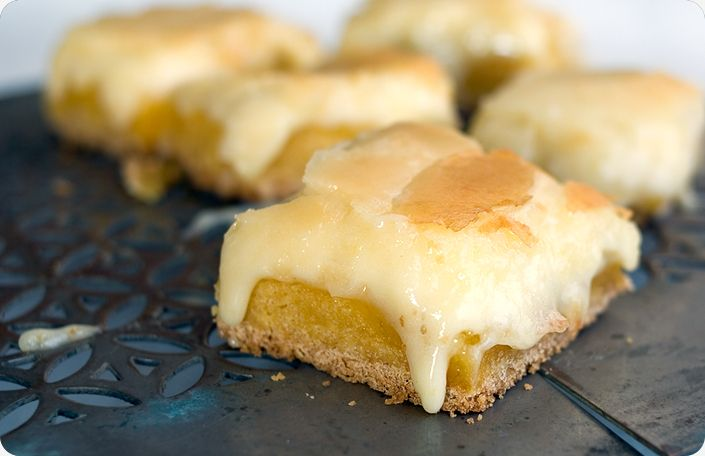 Ooey Gooey Butter Cake Bars      Ingredients    1 box of yellow cake mix (1 pound)  4 ounces of butter, melted  3 eggs  8 ounces of cream cheese, softened  1 pound (16 ounces) of powdered sugar  1 tsp. of vanilla extract    Prepare    1. Preheat oven to 350 F. Line an 8 x 8 inch pan with parchment paper.    2. Make the base first: mix together cake mix, butter and 1 egg.    3. Pat into pan, create an even layer.    4. Mak