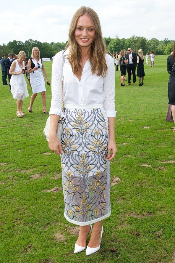 Laura Haddock.. Mother of Pearl skirt, with a long white shirt..