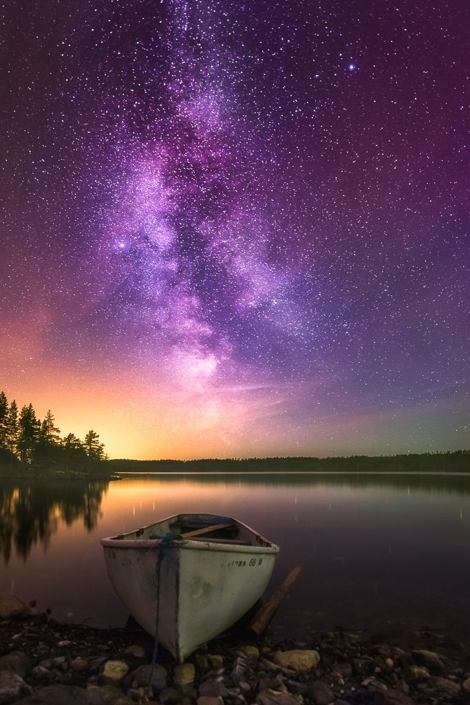 Triple by Ole Henrik Skjelstad: A milky way, a red aurora and a nice touch of light pollution.