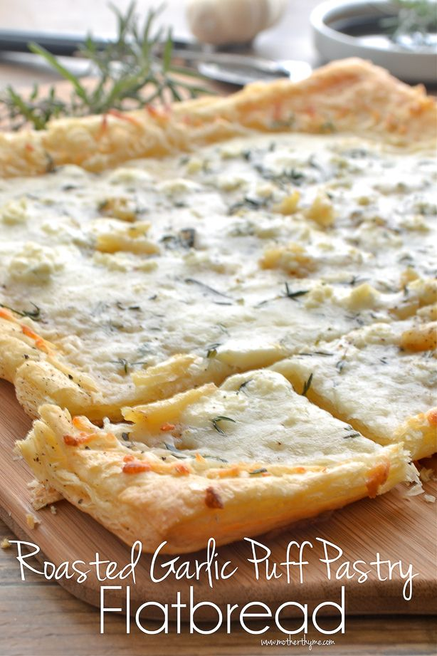 Roasted Garlic Puff Pastry Flatbread _ With Mozzarella & Gorgonzola cheese. Simple & elegant; a great appetizer for entertaining or to enjoy as an easy dinner. Remove rosemary sprig & drizzle Balsamic Reduction over flatbread or serve on the side!