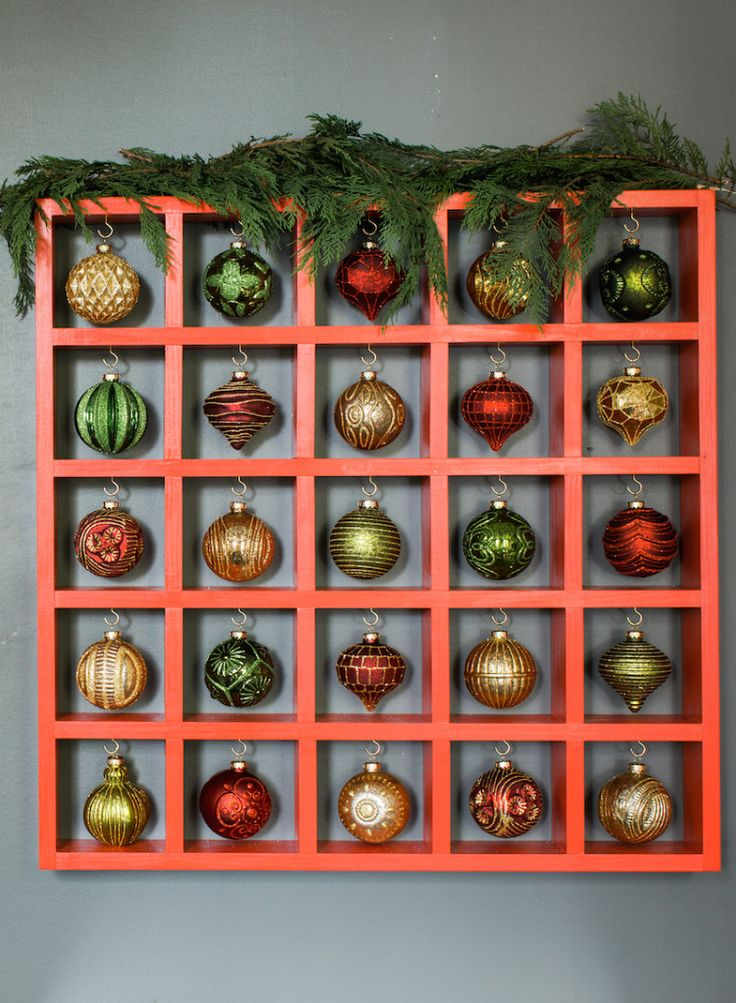 These holiday door decorating ideas from DIYer Kelly Marzka are perfect for anyone with a small front porch. You just need garland, lights and poinsettias.