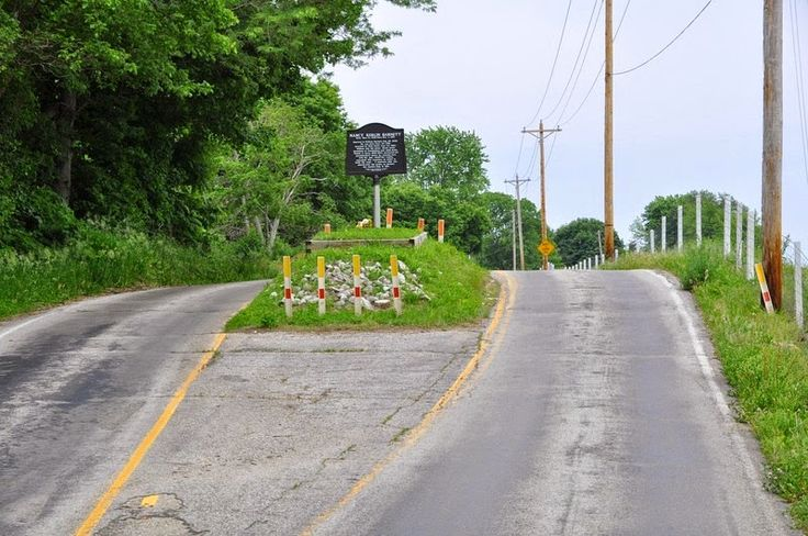 In the middle of East County Road 400 South, near Amity, in the state of Indiana, in the U.S., is a small mound of earth that splits the asphalt road along its length. That mound is the grave of Nancy Kerlin Barnett (1793-1831).