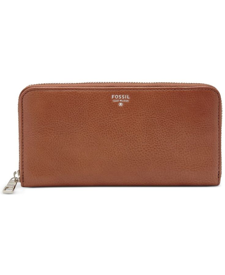 A symmetrical design makes it easy to find your cards, cash, coins and Id in Fossil's sleek leather zip-around wallet. | Imported | Leather | Zip-around closure | Exterior features shiny gold-tone har