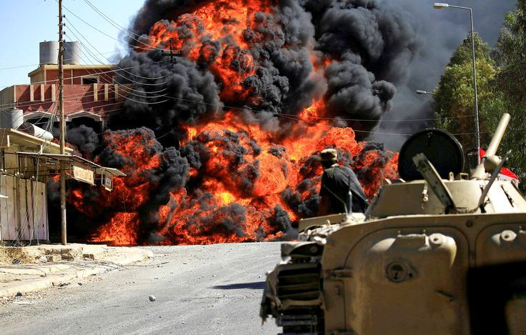 Smoke rises during clashes between joint troops of the Iraqi army and Shiite Popular Mobilization Forces against ISIS militants in Tal Afar, Iraq, on Aug. 26.