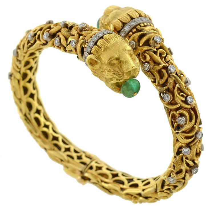9800 1960s Zolotas Emerald Diamond Gold Lion Bracelet | From a unique collection of vintage bangles at https://www.1stdibs.com/jewelry/bracelets/bangles/