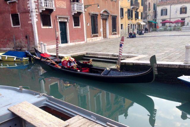 Venice, Italy - gondolier snoozing on his gondola
