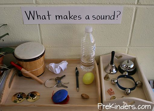 "This science center display helps children explore sound with common objects. I collected ""found"" items to display on the tray with a sign, ""What makes a sound?"", to invite children to explore. The first tray has a variety of common ""found"" objects, and the second tray has a collection of various types of bells. Objects I …"