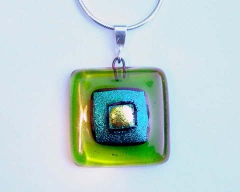 "Paula Woodward - A square fused glass pendant made from dichroic and fusing glass.   The pendant is fitted with a sterling silver bail and comes complete with a 16"" or 18"" sterling silver snake chain. Please let me know which length you would like when ordering. If no indication is given I will supply it with an 18"" chain. £22"