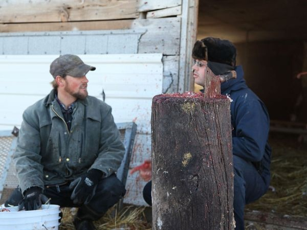 The Hutterites Toby and Wesley taking a break from butchering chickens.