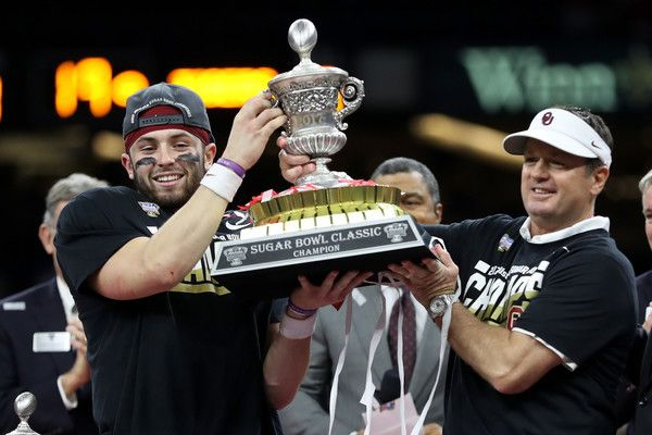 Head coach Bob Stoops and Baker Mayfield #6 of the Oklahoma Sooners hold the winner's trophy after defeating the Auburn Tigers 35-19 during the Allstate Sugar Bowl at the Mercedes-Benz Superdome on January 2, 2017 in New Orleans, Louisiana.