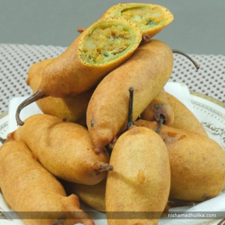 Rajasthani Mirch vada is prepared with thick and less spices green chilies, which are stuffed with little spicy-tangy potato stuffing.  Recipe in English- http://indiangoodfood.com/1046-rajasthani-mirchi-vada.html ( copy and paste link into browser)  Recipe in Hindi- http://nishamadhulika.com/1391-rajasthani-mirchi-vada-recipe.html ( copy and paste link into browser)