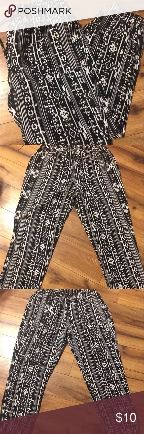 Kiss & Cry Medium Polyester Aztec Print Pants NWOT Never worn, pockets on the front, one pocket on back right, cuffs at the bottom. Kiss & Cry Pants Track Pants & Joggers