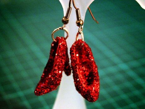 Finally! Something to do with those darn things... Barbie shoes + glue + glitter =Dorothy shoe earrings!