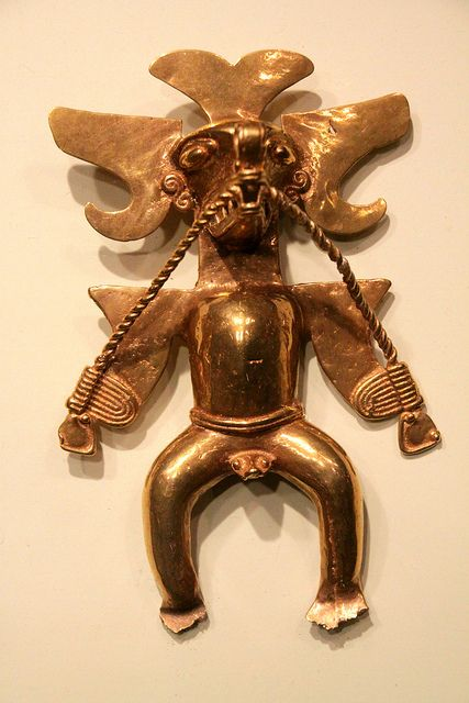 From the Gold Museum collection, San Jose, Costa Rica. About three inches in height. It is believed that gold images such as this represented various tribes during the pre-columbian era.
