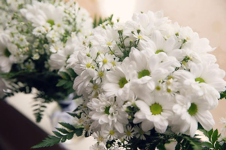 We made our bouquets - very simple, we used electrical tape to hold the bouquet together with white ribbon to disguise the tape! Easter daisies, fern leaf, gypsophila & white chrysanthemums
