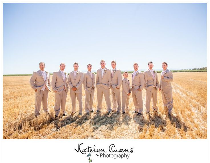 Tan groomsmen suits. Field groomsmen