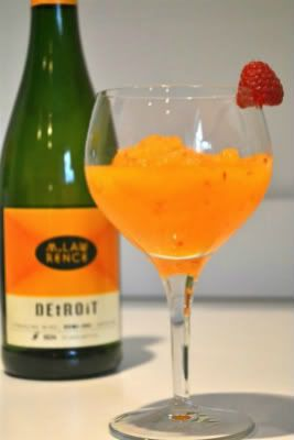 Peach Bellini Recipe ~ popular Italian drink 8 oz. of Sparkling Wine 6 oz. of Peach Puree (or any other fruit puree) Handful of Fresh Raspberries 1 1/2 Cups of Ice 1 Pinch of Sugar Put everything into a blender and mix until the ice is fully pureed.