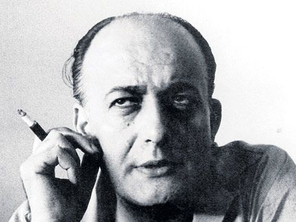 """Nikos Gatsos ( 1911-1992) Greek poet, translator, lyricist.His work as a whole combines universal poetic themes such as problems of evil, injustice, sacrifice, and the pains of love, with more specifically Greek concerns such as the sorrows of exile. His capability to handle language led the Art and National Theatre"""" to entrust him with translations of various plays -1st and foremost being """"Blood Wedding"""" by Lorca. He had a special relationship with Hadjidakis and N.Mouskouri."""