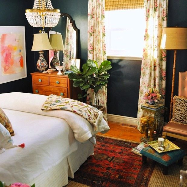 Eclectic bedroom - Navy Walls - orangey furniture - bamboo shade - love this style!