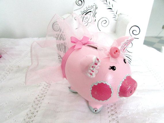Pretty Pink Ballerina Piggy Bank wearing a tu tu, The bank is sparkly with a rhinestone on each toe and a sparkle finish on the piggies cheeks, nose,