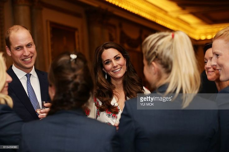 Britain's Prince William, Duke of Cambridge, (L) and Britain's Catherine, Duchess of Cambridge, meet members of the British Olympic womens hockey team, as she meets athletes during a reception for Team GB's Olympic and Paralympic athletes, hosted by Britain's Queen Elizabeth II, at Buckingham Palace in central London on October 18, 2016.Britain's stars of this year's Olympic and Paralympic Games in Rio attended an 'amazing' reception at Buckingham Palace -- the official London home of Queen…