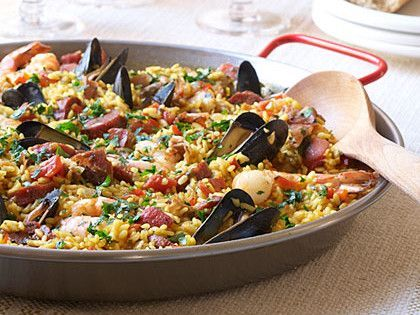 Traditional Spanish Paella | Nourishing, vibrant, and served without pretension, paella has held a place of honor and practicality in Spanish homes for centuries. If mussels aren't your favorite, you can easily substitute littleneck clams in their place--just be sure to thoroughly scrub the clams' shells in cold water before using. To round out the meal, choose a good Spanish red wine from the Rioja region, grab a crusty baguette, and serve with a light salad. #spanishmeals