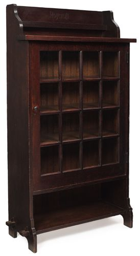Roycroft - Single Door Bookcase. Oak with Glass and Bronze Hardware. East Aurora, New York. Circa 1910.