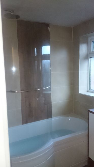 Wood accent wall tile  P shaped bath  Shower screen with towel rail
