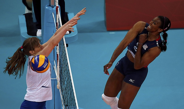 Olympics: USA women's volleyball team sweeps Serbia  Danielle Scott-Arruda (R) of the U.S. spikes against Serbia's Brankica Mihajlovic during their women's Group B volleyball match at Earls Court during the London 2012 Olympic Games August 3, 2012. (REUTERS/Ivan Alvarado)