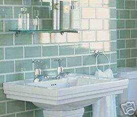 Beautiful green tiles from Fired Earth, with Victorian styled bathroom sink and fittings.
