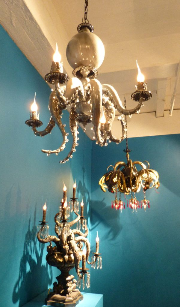 Wicked cool octopus chandeliers with white and red crystals.