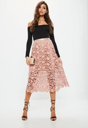 8b9f425f3 Score a wardrobe win with this elegant midi skirt - featuring a blush pink  hue and crochet lace overlay. This piece is full bodied with a waist  clinching ...