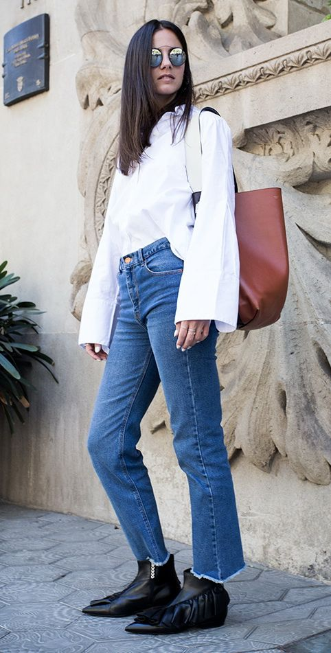 simple blue jeans and a cool white shirt with extra large cuffs