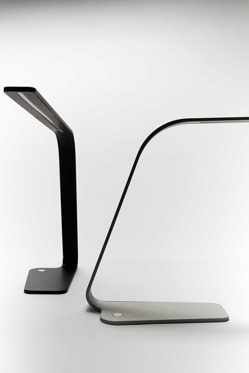 TLS Lamp is a thin and elegant task lamp that celebrates the beauty of well balanced minimal design. The main body is machined from 6mm aluminium then bent into its simplistic form. The intricate design process achieved a stable and well balanced extremely thin lamp that looks sleek in the bedroom or workstation. Available in high quality aluminium black or clear anodized finish with a dimmable LED light source and a touch sensitive backlit switch.        Designed by Viktor Legin & Chris…